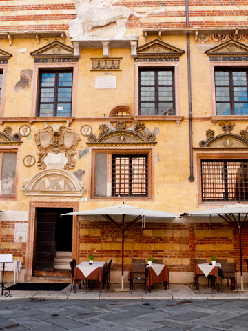 A small restaurant patio in Piazza dei Signori in Verona, Italy