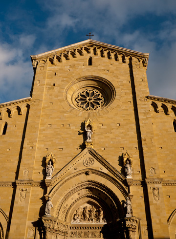 In Arezzo, Italy, the duomo glows in the late afternoon light.