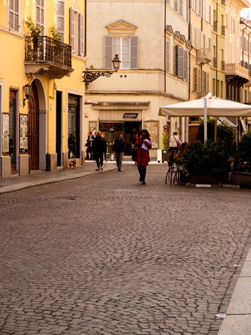 An afternoon street scene in Parma, Italy