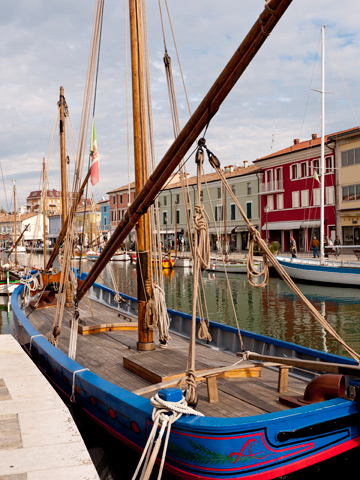 Boats along a canal in Cesenatico, Italy
