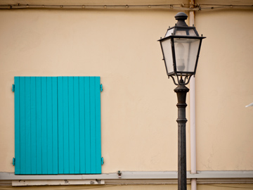 A street light and wooden shuttered window in Cesenatico, Italy