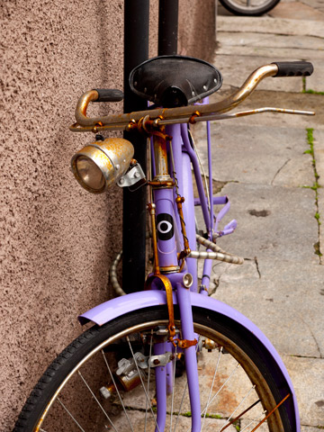 A purple bicycle in Parma, Italy