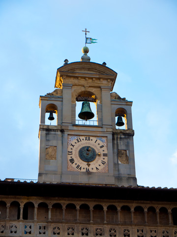 A clock and bell tower on the Lay Fraternity in Arezzo, Italy