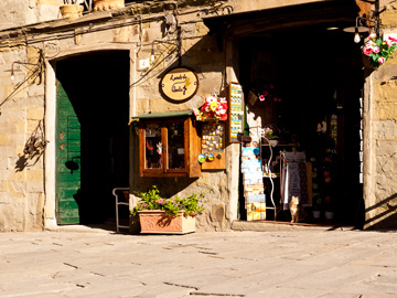 Light and shadows over a store in Cortona, Italy