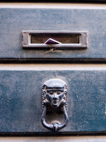 An egyptian-styled door knocker in Italy