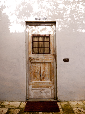 A white-washed wooden door in Tuscany, italy
