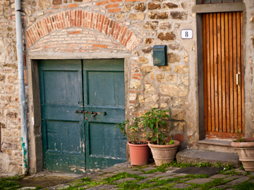 The entrances to a home in Tuscany, Italy