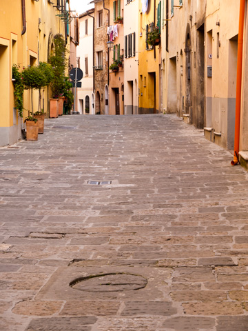 A cobblestone, residential street in Montepulciano, Italy.