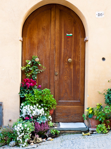 In Montepulciano, Italy an entrance is decorated with plants, flowers and a Bulgarian flag sticker