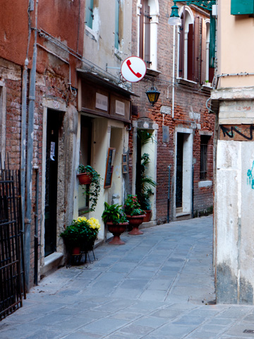 A winding alleyway in Venice, Italy.