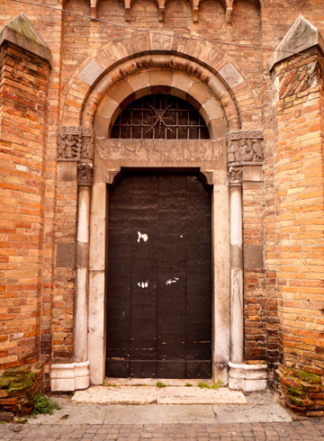 The entry way of this church in Bologna, Italy features original Roman marble and an inscription to Caesar