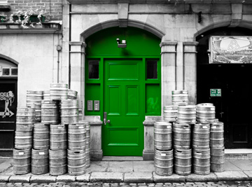 A green door and beer kegs in Dublin, Ireland