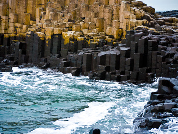 Waves of the Irish Sea lap against the Giant's Causeway