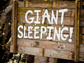 A wooden sign warns of a sleeping giant in Ireland.