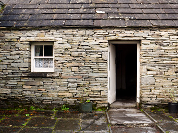 The entrance to an old stone country home in Ireland.