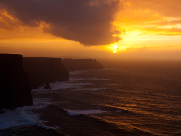The sun sets over the Cliffs of Moher in Ireland