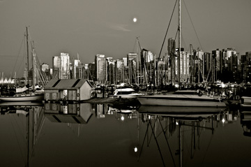 A harbour sits at the forefront of the Vancouver skyline in British Columbia, Canada