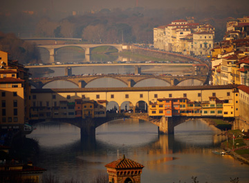 The bridges of Florence stretch across the Arno River