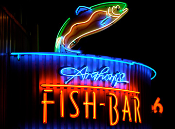 A neon sign advertises Anthony's Fish Bar in Seattle, Washington