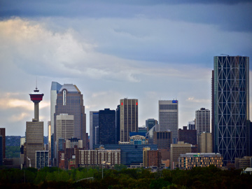 The Calgary tower stands amongst the skyline of highrises in Alberta