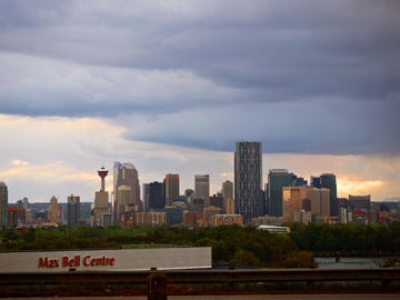 Max Bell Centre sits in front of the downtown skyline of Calgary, Alberta