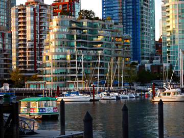 The waters of False Creek serve as home to harbours and foot ferries in Vanocuver, BC