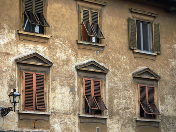 Windows & shutters adorn this apartment building in Florence