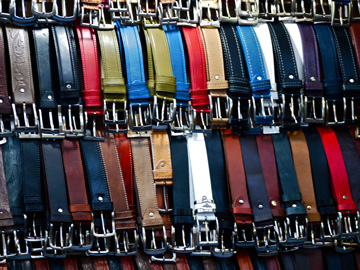 Belts displayed at a market stall in Florence, Italy