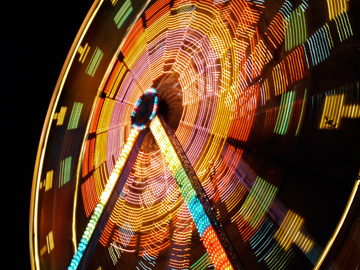 A ferris wheel in motion at night