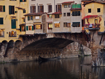 The Ponte Vecchio stands over the Arno River in Florence, Italy