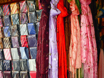 Scarves displayed at a market stall in Florence, Italy