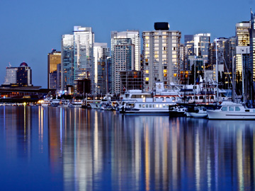 Reflections at dusk on the waters north of downtown Vancouver, Canada