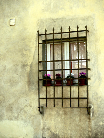 A barred window in the Boboli Gardens in Florence, Italy