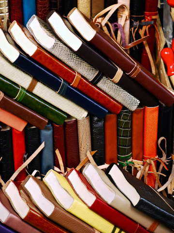 Leather-bound journals on display at a market stall in Florence, Italy