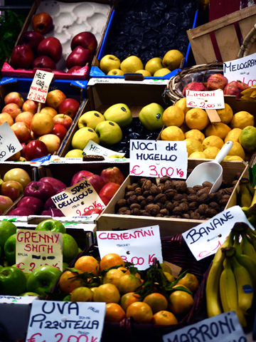 Fruit and nuts on display at San Lorenzo Market in Florence, Italy