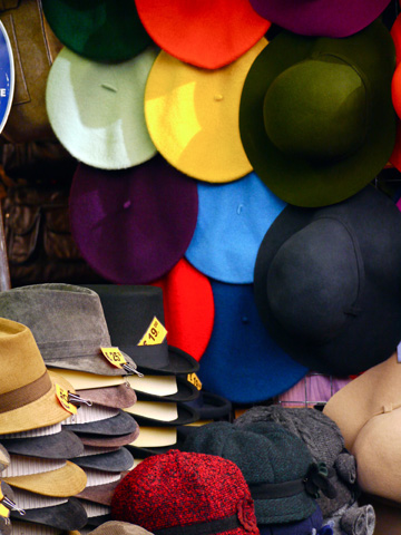 Hats displayed at a market stall in Florence, Italy