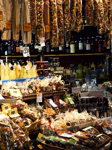 A stall selling pasta, wine and truffles to tourists in the San Lorenzo Market in Florence, Italy