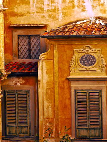 Decorative windows on the back of the Pitti Palazzo in Florence, Italy