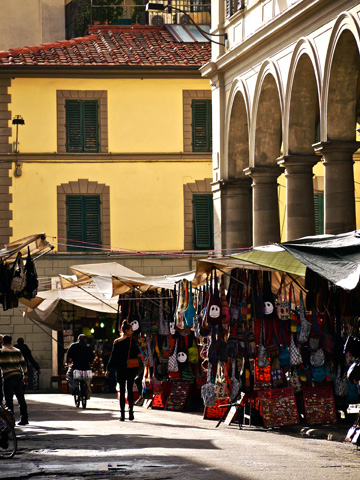 Shopping outsite of the San Lorenzo Market in Florence, Italy