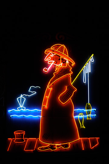 A neon sign sporting a fisherman at Fisherman's Wharf in San Francisco, California